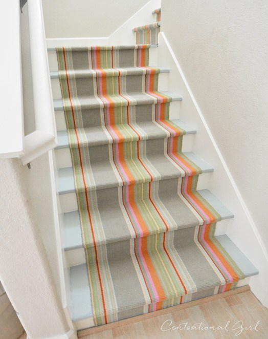 Furbish Studio - Marina Cay Striped Indoor/Outdoor Rug in soft sage, taupe, aqua, and orange shown as stair runner