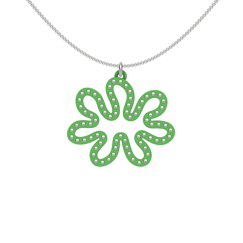 MATISSE.cutout  CORAL pendant  STYLE:  3 , oriented horizontally with sterling silver studs along shape  COLOR:  grass  green    MATERIAL:  3D printed Nylon  ARTIST:  Ree Gallagher, USA