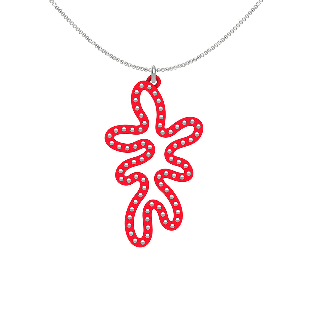 MATISSE.cutout  CORAL pendant  STYLE:  5   vertical coral shape  with sterling  studs along shape  COLOR:   red    MATERIAL:  3D printed Nylon  ARTIST:  Ree Gallagher, USA