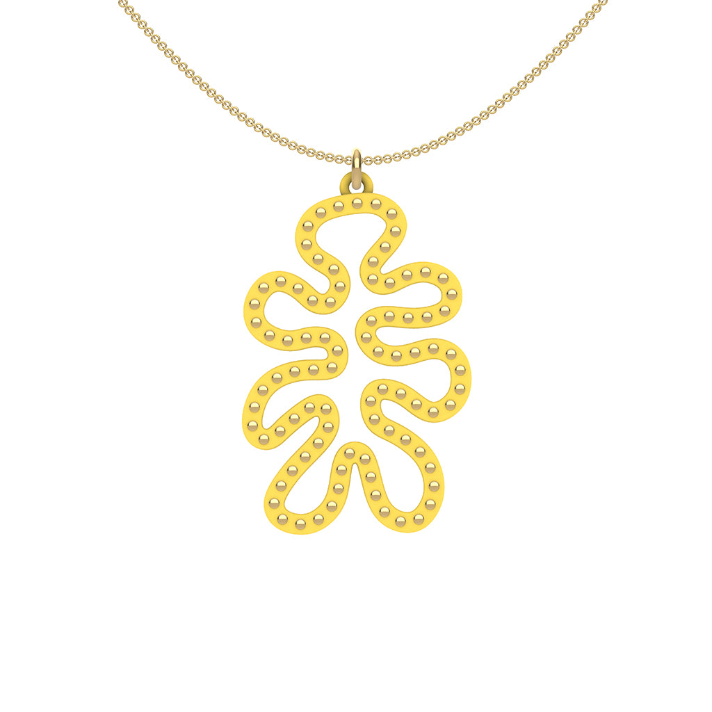 MATISSE.cutout  CORAL pendant  STYLE:  4 , funky vertical shape  with 14/20 goldfill studs along shape  COLOR:   yellow    MATERIAL:  3D printed Nylon  ARTIST:  Ree Gallagher, USA