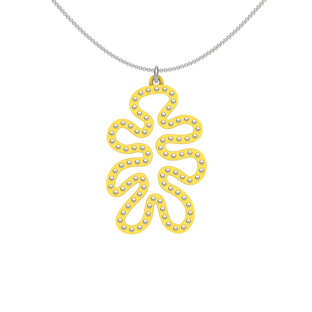 MATISSE.cutout  CORAL pendant  STYLE:  4 , funky vertical shape  with sterling  studs along shape  COLOR:   yellow    MATERIAL:  3D printed Nylon  ARTIST:  Ree Gallagher, USA