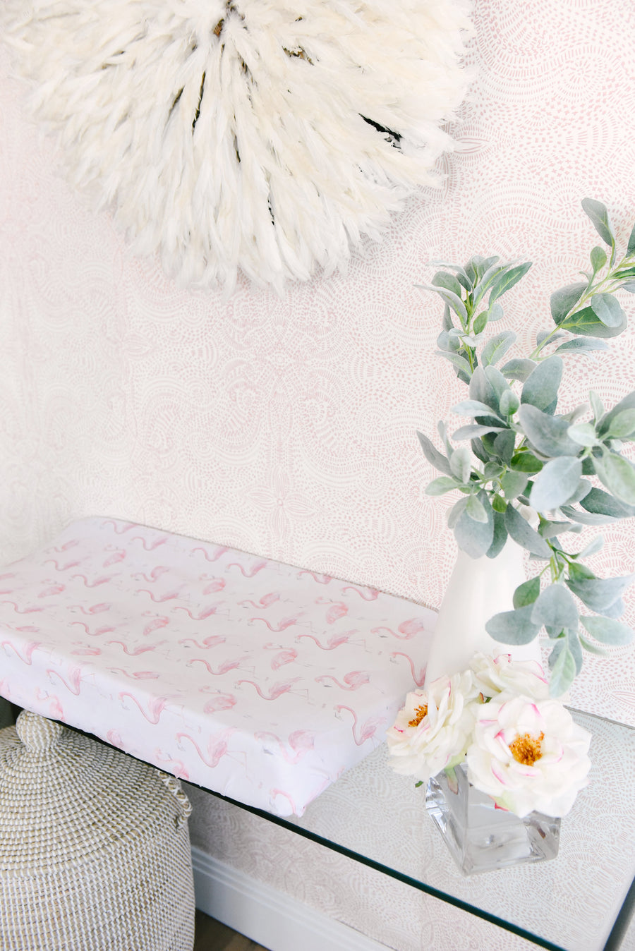 flamingo changing pad cover on table