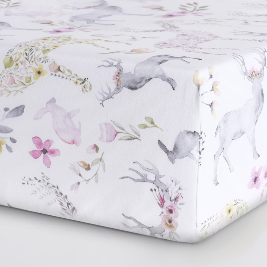 closeup of woodland crib sheet design