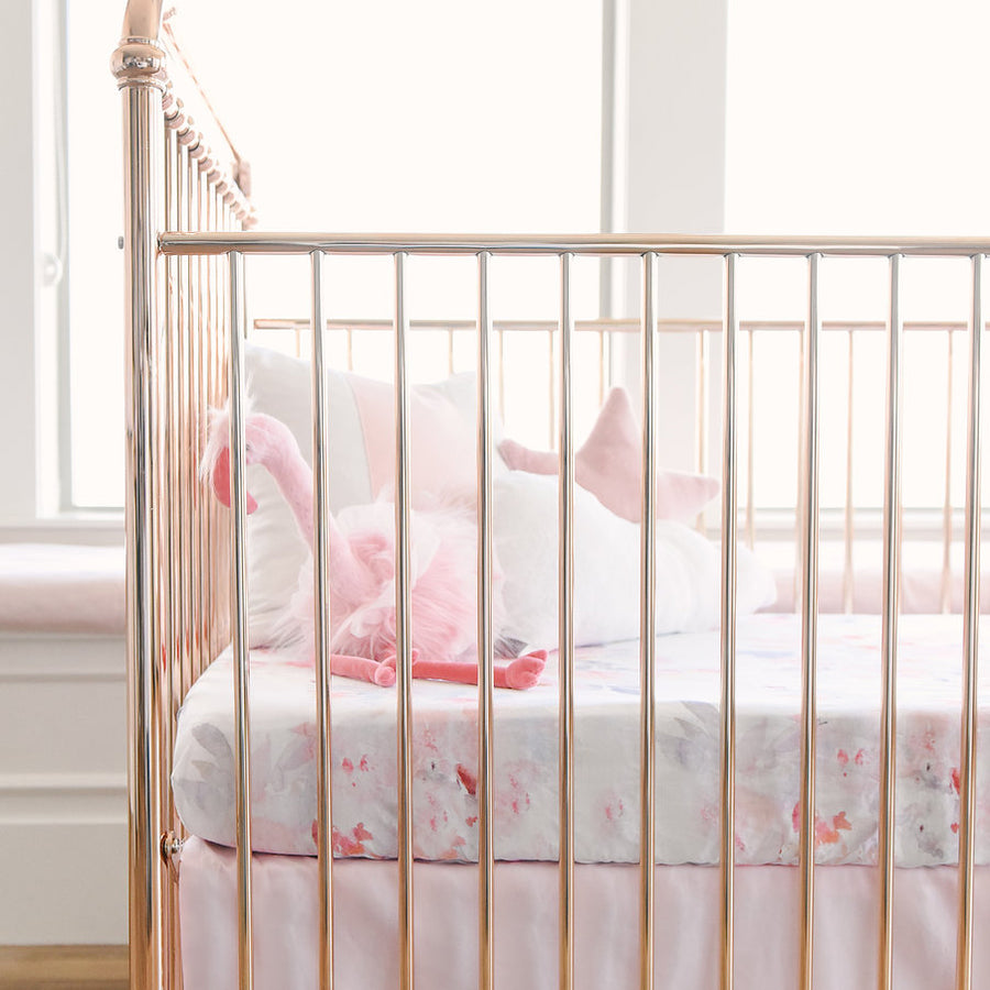 pink flamingo in crib