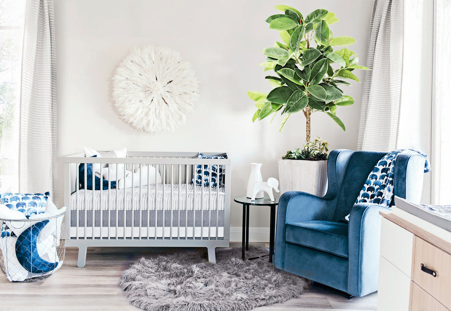 elephant designed nursery with glider
