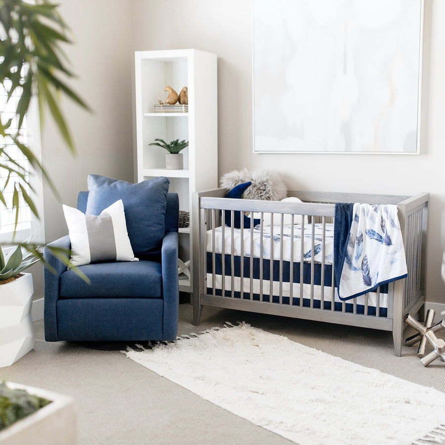 nursery with feather blanket