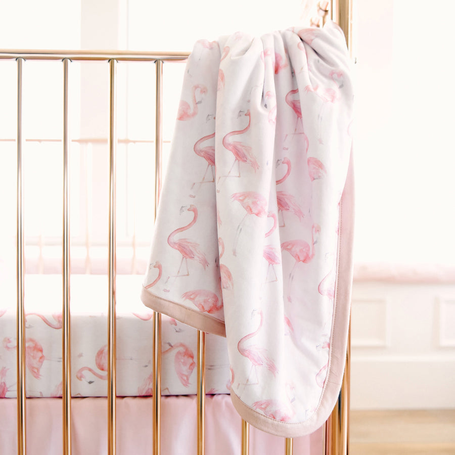 flamingo blanket hanging on crib