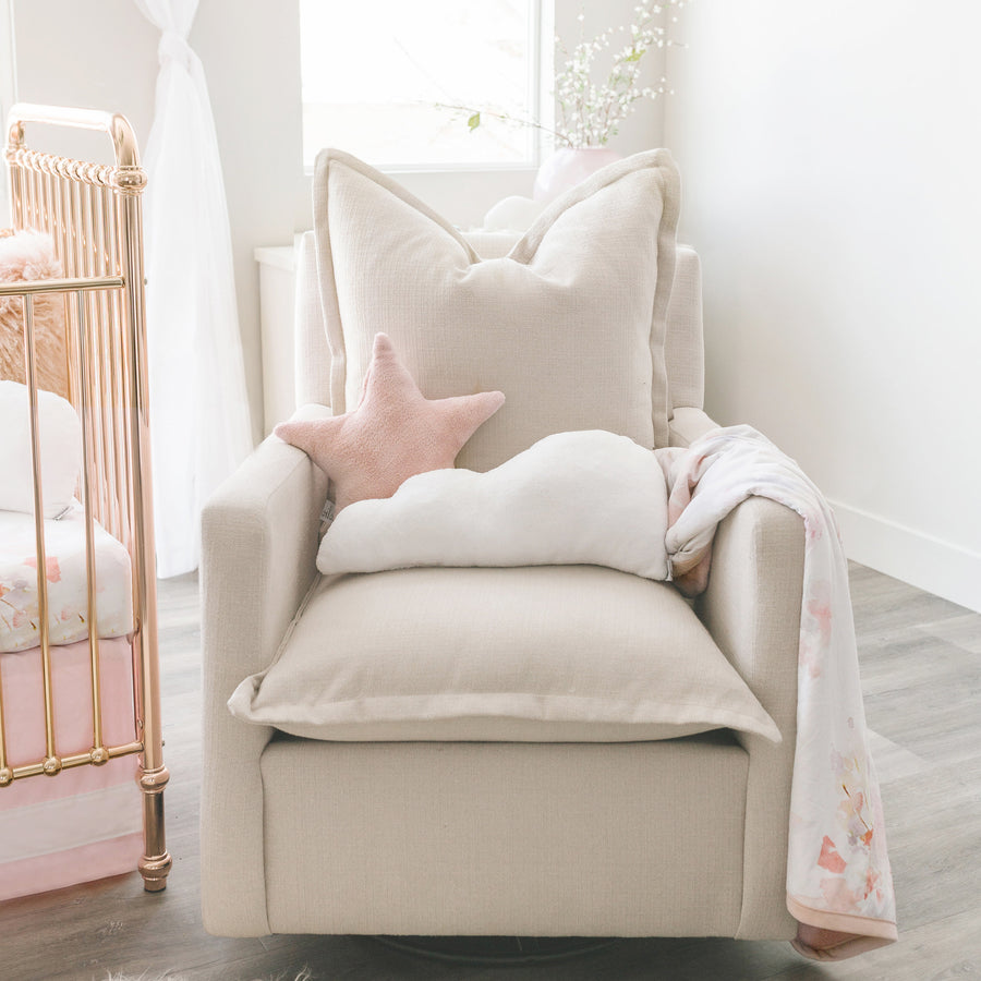white cloud pillow in nursery glider chair