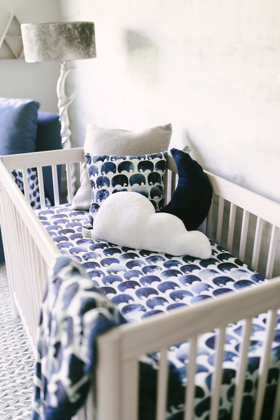 crib with elephant pillow and blanket
