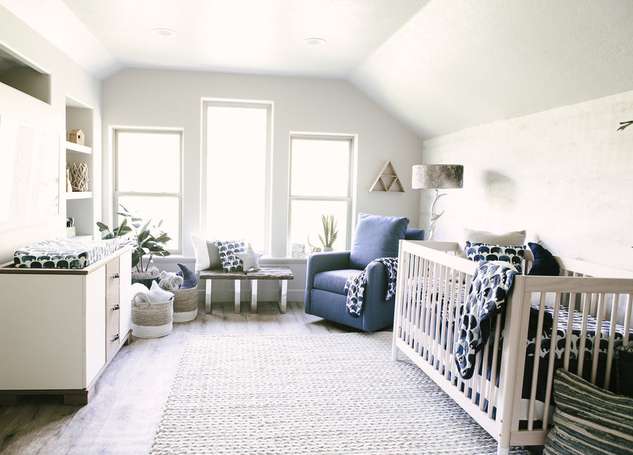 nursery room with crib