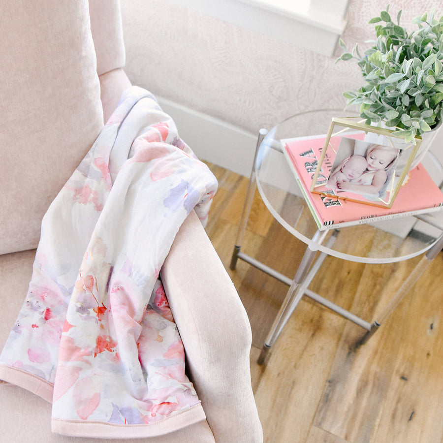 glider chair with floral baby blanket