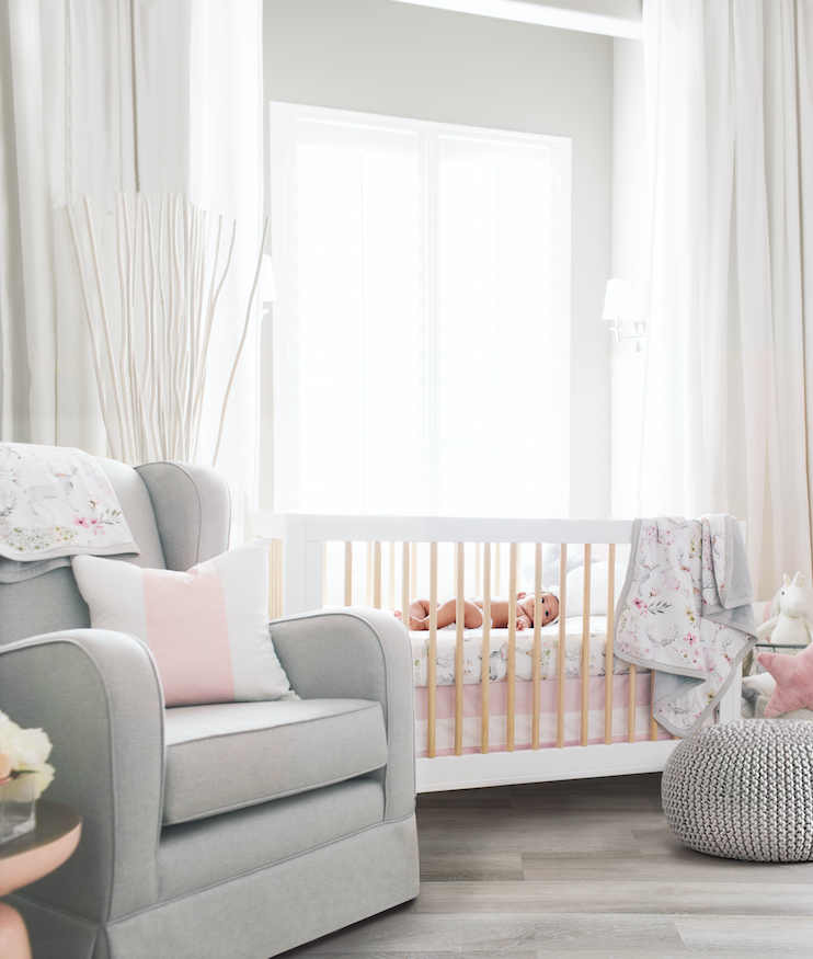 crib in nursery room