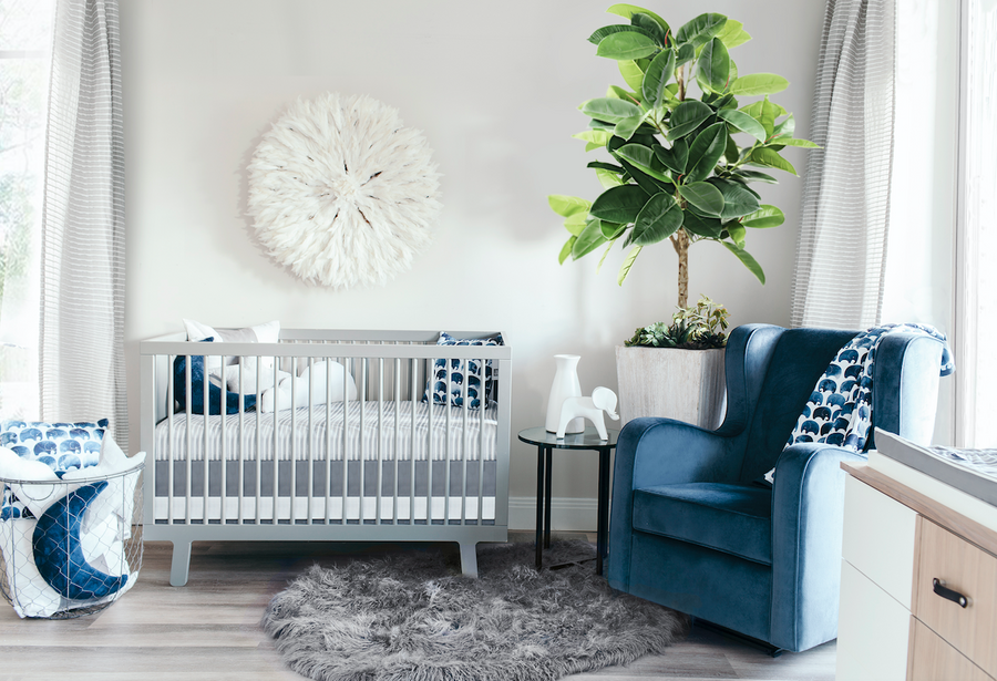 indigo nursery room with glider