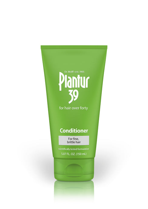 Green bottle with white text. Plantur 39: for hair over forty. Conditioner for fine, brittle hair.