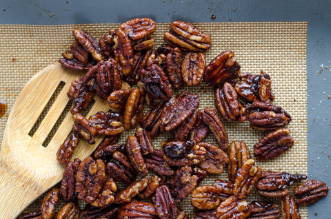 pecans on tray with maple syrup