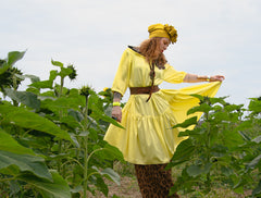 woman standing in sunflowers wearing ausus