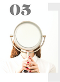 woman with mirror in front of her face