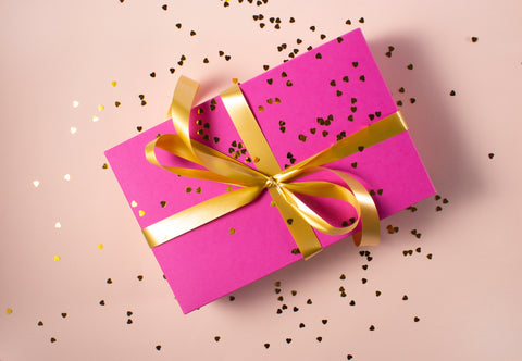 present wrapped in pink paper