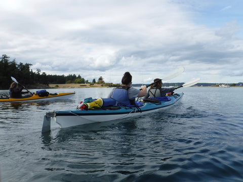 Two kayaks set off on an adventure around the San Juan Islands.