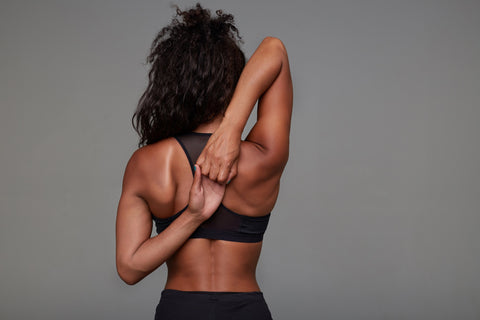 Women stretching her back