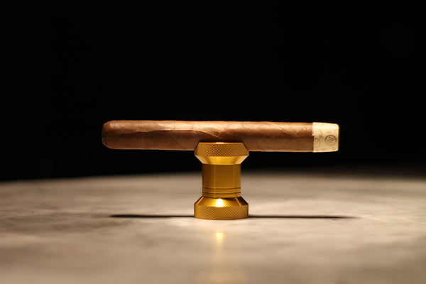 Gold cigar stand and bottle opener.