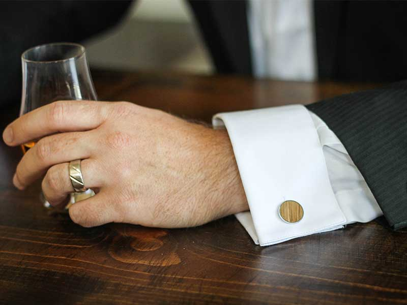 cufflinks made from a whiskey barrel