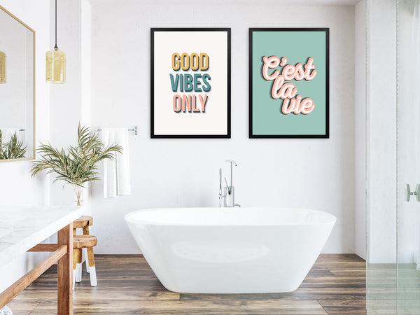 A collection of bathroom wall art prints in a bathroom setting with bath