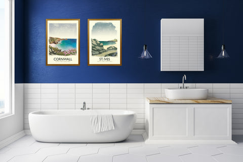 Blue bathroom with a set of two travel art prints of cornwall and the south west