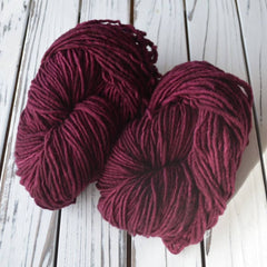 single ply worsted weight yarn in a wine red colour called Chianti