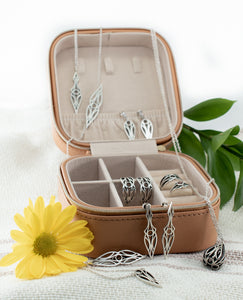 A collection of sterling silver art deco teardrop and dagger jewellery in a jewellery case. Pendants, necklaces, earrings, and bracelets.