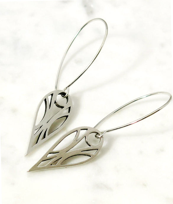 Art deco geometric teardrop hoop earrings of sterling silver with a high-sheen brushed finish and oxidized for contrast on a white background.