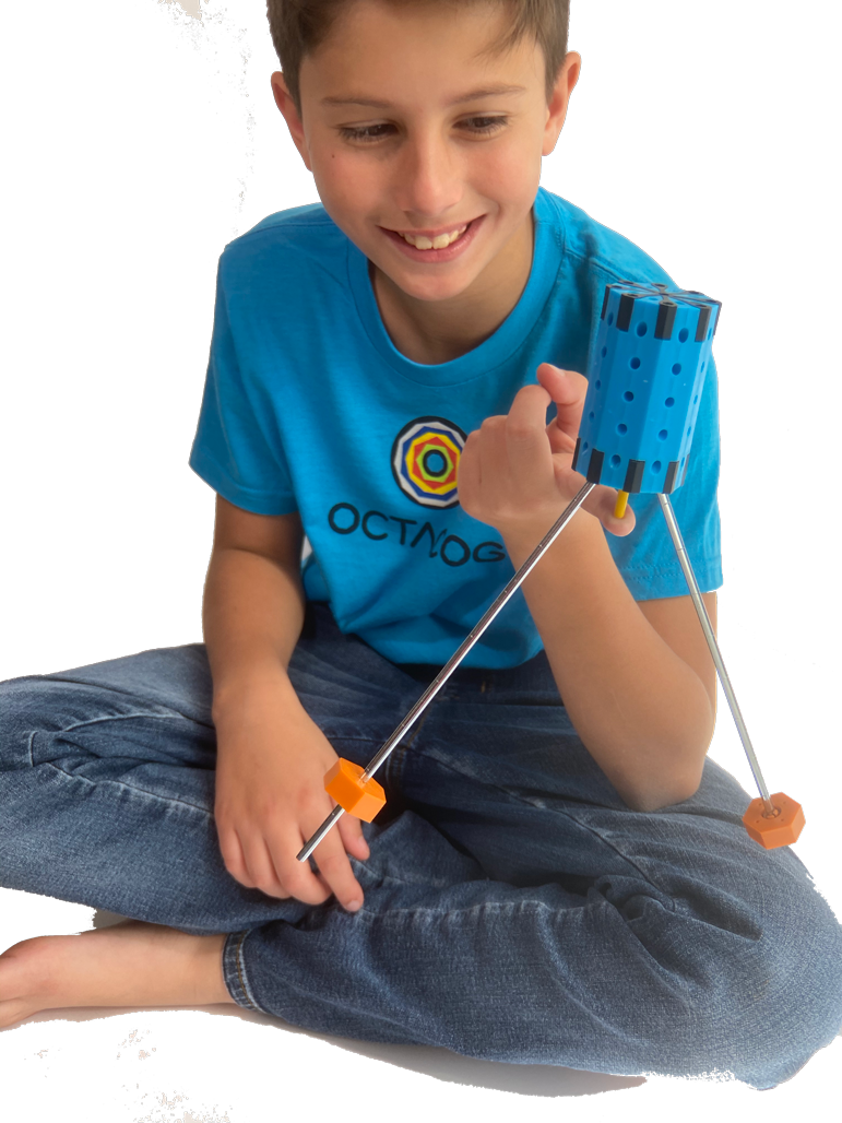A child balancing Octacog on a finger.