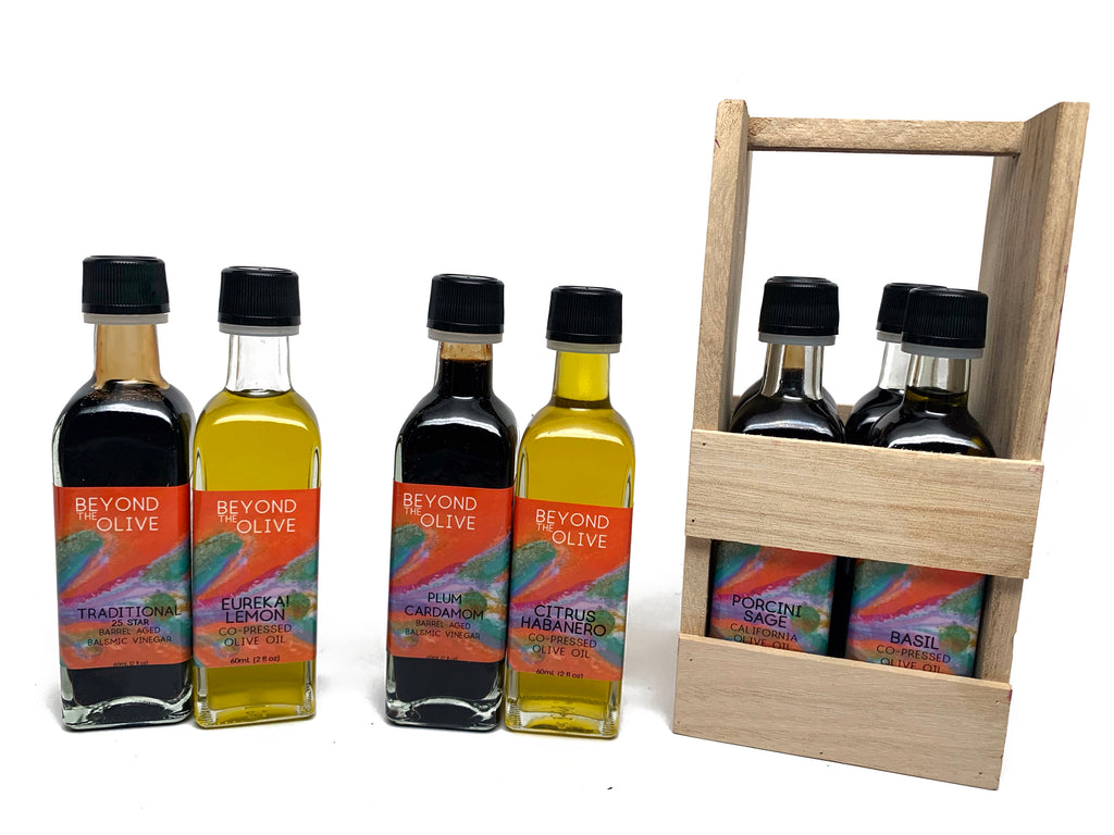 4 pack of 2 oz extra virgin olive oils and balsamic vinegars in a wood crate