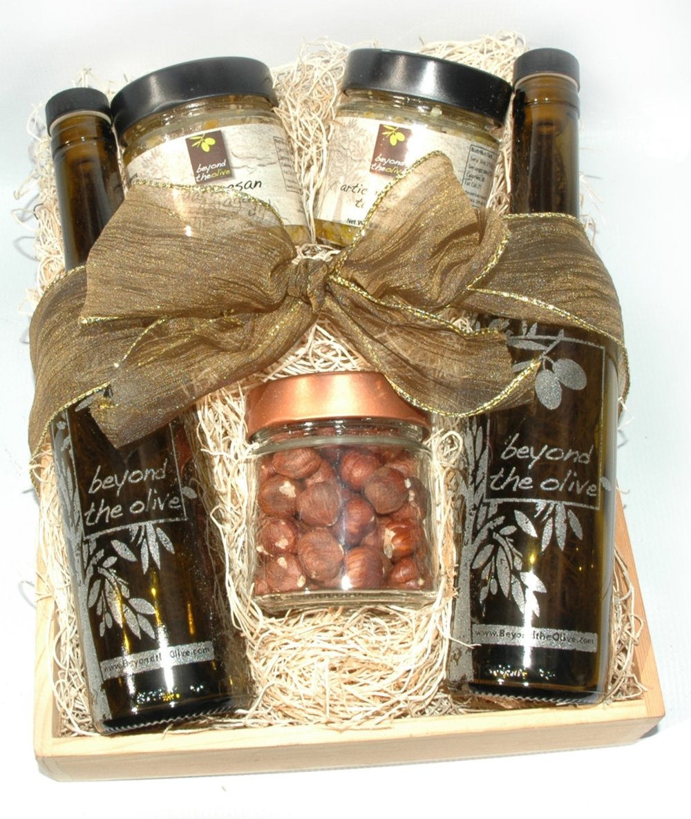Two bottles of 375 ml size.  One with olive oil, one with balsamic vinegar.  Three small jars with tapenade or nuts.  All inside a wood crate with a big bow