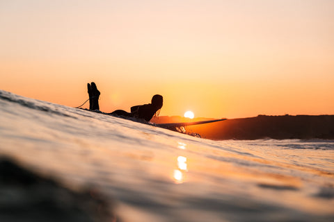 Surfer in Cornwall at sunset