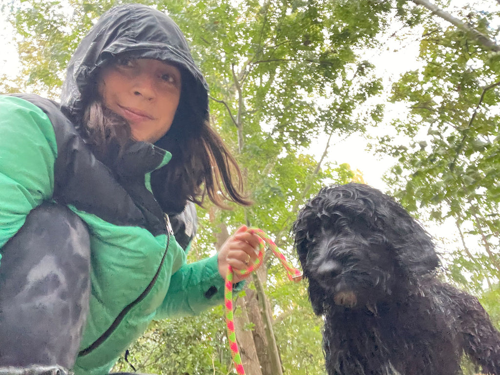 PR expert Lucy Werner standing outside in the rain with her dog