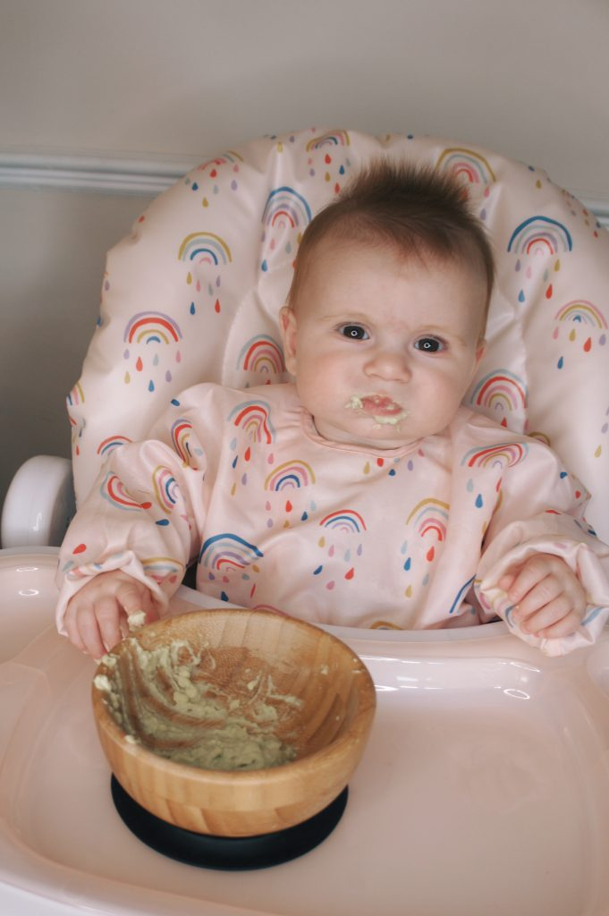Overhead image of baby Posey feeding in the Snax highchair