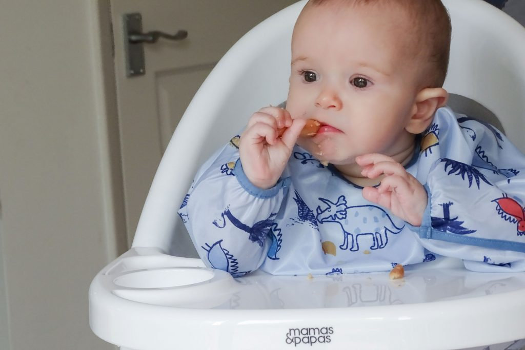 A close up of the highchair tray as baby Marlow is eating.