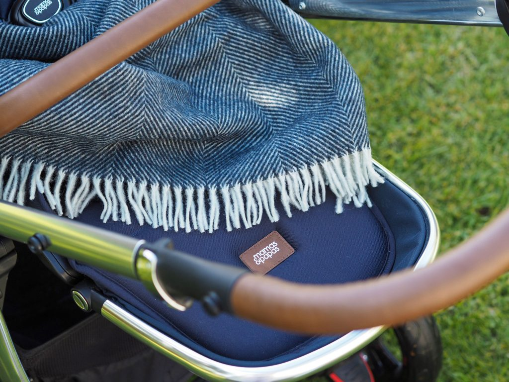 Close up of the Ocarro Moon's leatherette pushchair handle.