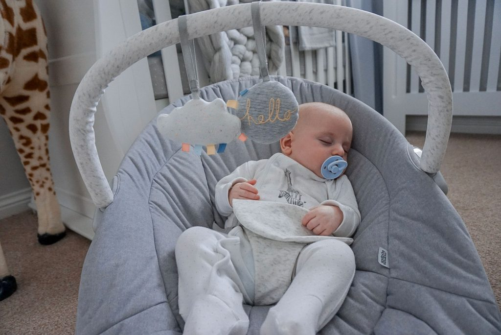 Baby Theo asleep in the Apollo cradle.