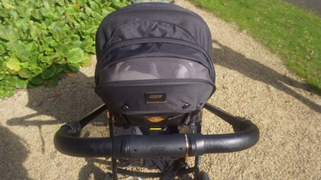 A close up of the Flip XT3 Black Copper pushchair hood and handlebar.