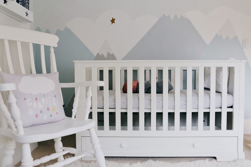 Cot bed and Bedding review - image of baby Gabriel in the cotbed, in a brightly lit nursery