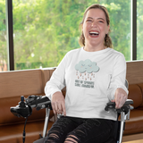 woman in wheelchair wearing white long sleeve tee out of spoons still thankful