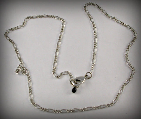 Chain: Silver finish Figaro chain with clasp