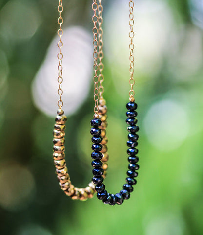 Available in Gold and Mystic Garnet