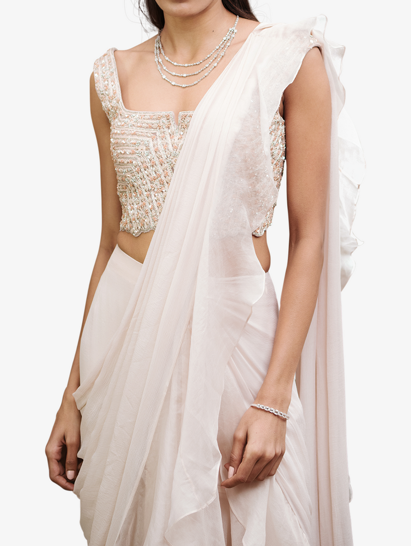 Heavily embroidered blouse with organza sari