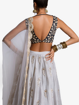 Embroidered choli with grey lehenga and net dupatta