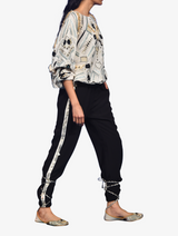 Chalk white georgette embroidered top and black jogger pants with crepes