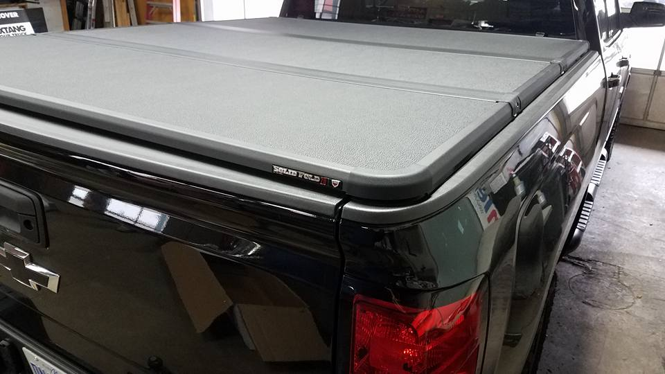 Extang Solid Fold 2.0 Chevy GMC Truck Bed Tonneau Covers