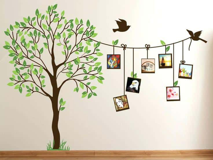 tree wall decal in green and brown with birds holding up photos on clothesline